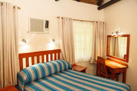 Badplaas, A Forever Resort: 4-Sleeper Rondavel. 2 bedrooms (1 double & 2 single rooms)